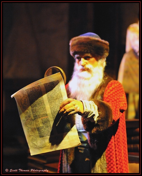 Johann Gutenberg examining a page from his printing press inside Spaceship Earth in Epcot, Walt Disney World, Orlando, Florida