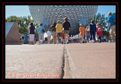 Guests entering Epcot walking towards Spaceship Earth, Walt Disney World, Orlando, Florida