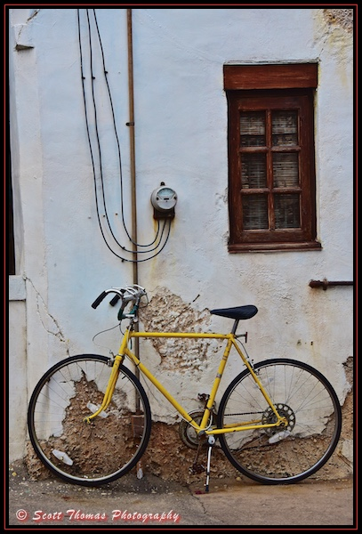 A bike leaning against a building in Harambe at Disney's Animal Kingdom, Walt Disney World, Orlando, Florida