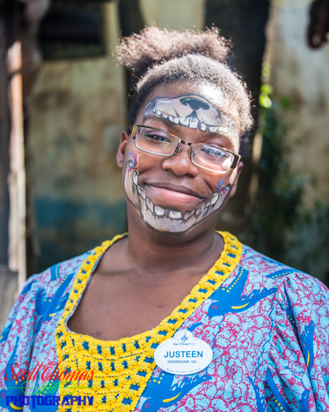 Cast Member Face Painter in the African village of Harambe at Disney's Animal Kingdom, Walt Disney World, Orlando, Florida
