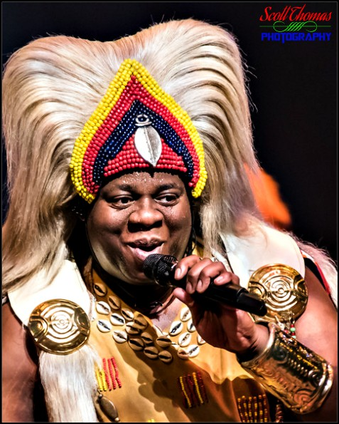 Singer performing during the Festival of the Lion King live show in Africa at Disney's Animal Kingdom, Walt Disney World, Orlando, Florida