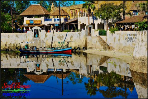 Africa's Harambe Theatre reflected in the Discovery River in Disney's Animal Kingdom, Walt Disney World, Orlando, Florida