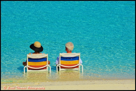 A couple enjoying Serenity Bay on Disney Cruise Line's Castaway Cay, Bahamas