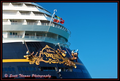 Sorcerer's Apprentice Mickey Mouse cleans the bow of the Disney Dream cruise ship, Disney Cruise Line, Bahamas