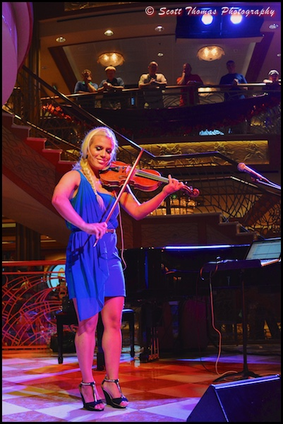 Greta Salóme performing in the Atrium of the Disney Dream cruise ship