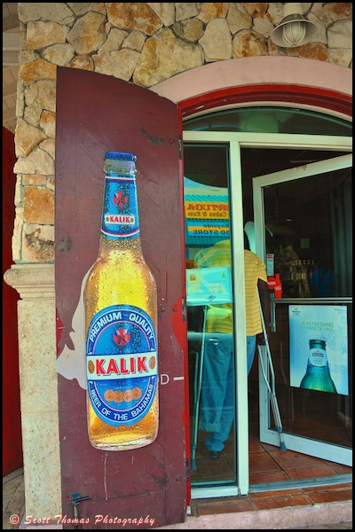 Advertising sign for Kalik beer, the official beer of the Bahamas, on a shop door in Nassau, Bahamas