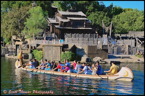 Guests paddling a Davy Crockett Explorer Canoe on the Rivers of America at Disneyland in Anaheim, California