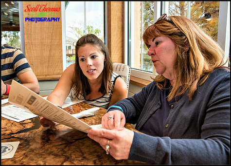 Daughter helping her mother with menu choices at Homecoming restaurant in Disney Springs, Walt Disney World, Orlando, Florida