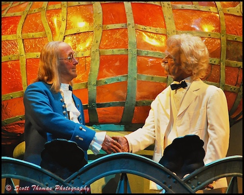 Benjamin Franklin and Mark Twain shake hands in the closing scene of the American Adventure audio-animatronics show in Epcot's World Showcase, Walt Disney World, Orlando, Florida