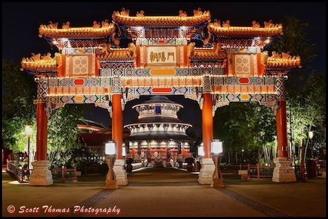 Paifang Gate in front of the Hall of Prayer for Good Harvest at night in the China pavilion in Epcot's World Showcase, Walt Disney World, Orlando, Florida