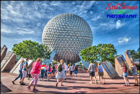 Guests walking towards Spaceship Earth after rope drop in Epcot's Future World , Walt Disney World, Orlando, Florida