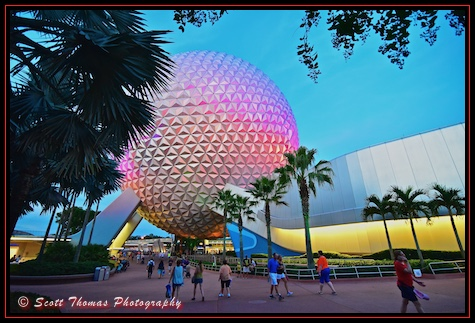 Late day sunlight mixes with lighting on Spaceship Earth in Epcot's Future World, Walt Disney World, Orlando, Florida