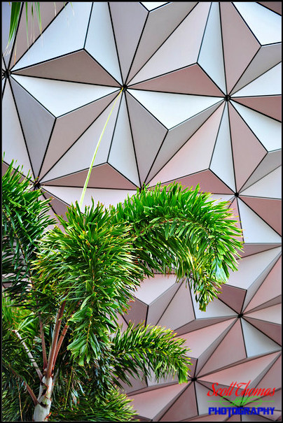 Palm tree in front of Spaceship Earth in Epcot's Future World, Walt Disney World, Orlando, Florida