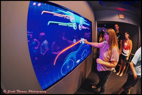 A young woman designing a car in the queue for Test Track in Epcot's Future World, Walt Disney World, Orlando, Florida