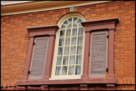 Rifle in a window of a building in Liberty Square at the Magic Kingdom, Walt Disney World, Orlando, Florida.