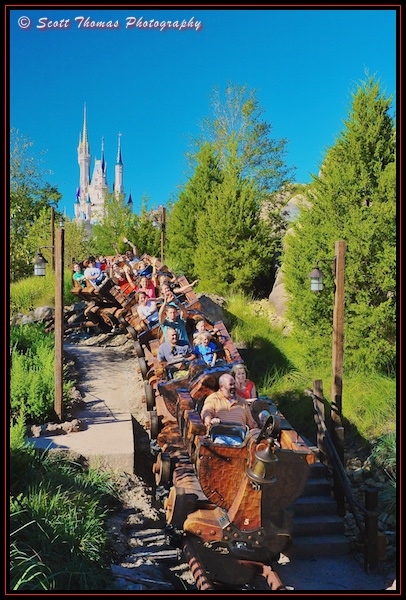 Guests ride the Seven Dwarfs Mine Train in the Magic Kingdom, Walt Disney World, Orlando, Florida