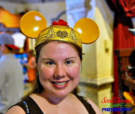 Young woman trying on a Belle Mickey Ears Hat in the Celebrity 5 & 10 shop at Disney's Hollywood Studios, Walt Disney World, Orlando, Florida