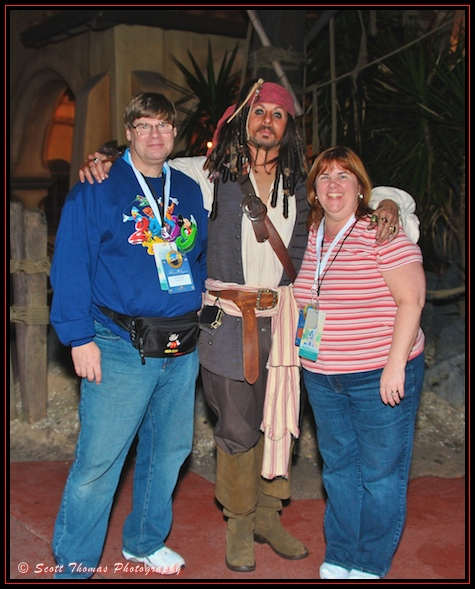 Blog photograher and his wife with Captain Jack Sparrow at the Magic Kingdom, Walt Disney World, Orlando, Florida