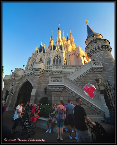 A red Mickey Mouse balloon behind Cinderella Castle in the Magic Kingdom, Walt Disney World, Orlando, Florida