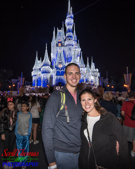 Couple portrait in the Magic Kingdom with Cinderella Castle lighted in the background, Walt Disney World, Orlando, Florida