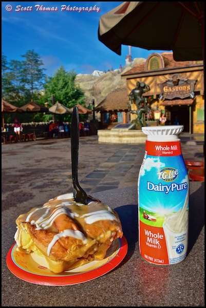 Warm cinnamon roll and cold milk from Gaston's Tavern in Fantasyland at the Magic Kingdom, Walt Disney World, Orlando, Florida