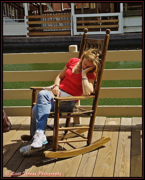 A guest takes a nap in a rocking chair on Tom Sawyer Island in the Magic Kingdom, Walt Disney World, Orlando, Florida