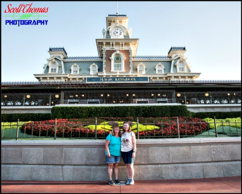 A mother and daughter in front of the Main Street USA Train Station at the Magic Kingdom, Walt Disney World, Orlando, Florida