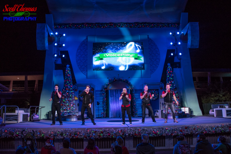 Voiceplay performing on the Rockettower Plaza Stage in Tomorrowland during a Mickey's Very Merry Christmas Party in the Magic Kingdom, Walt Disney World, Orlando, Florida