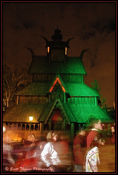 Guests look like Ghosts as they pass the Stave Church in Epcot's Norway pavilion, Walt Disney World, Orlando, Florida