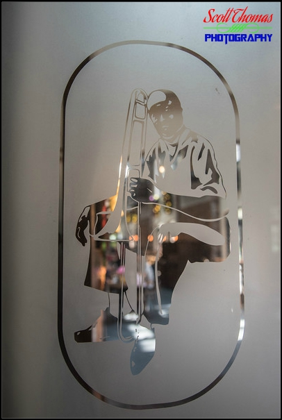 Glass etching of a musician with a trumpet at Disney's Port Orleans French Quarter resort, Walt Disney World, Orlando, Florida