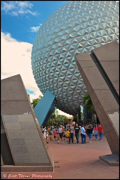 Guests are framed between Leave A Legacy structures near Spaceship Earth in Epcot, Walt Disney World, Orlando, Florida