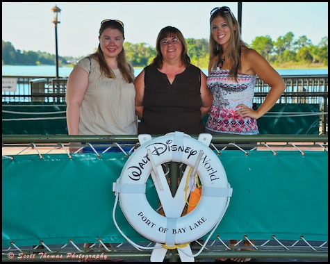 Members of a family getting ready to board a Motor Cruiser at the Magic Kingdom, Walt Disney World, Orlando, Florida