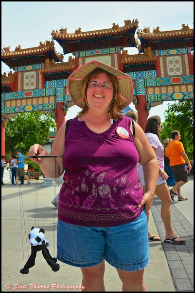 Vacationer posing at the China pavilion in Epcot, Walt Disney World, Orlando, Florida