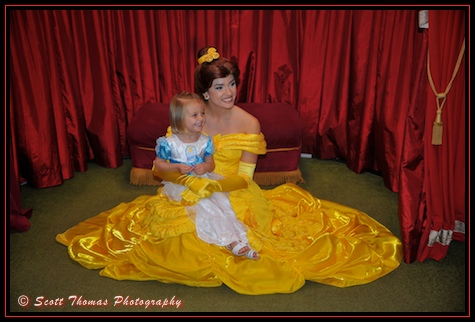 Belle in her Yellow Gown meets a young guest at the Magic Kingdom, Walt Disney World, Orlando, Florida