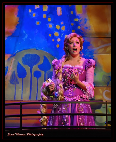 Rapunzel singing from the balcony in The Golden Mickeys in the Walt Disney Theatre on the Disney Dream cruise ship.