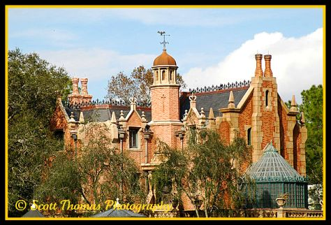 The Haunted Mansion in bright sun in the Magic Kingdom, Walt Disney World, Orlando, Florida.