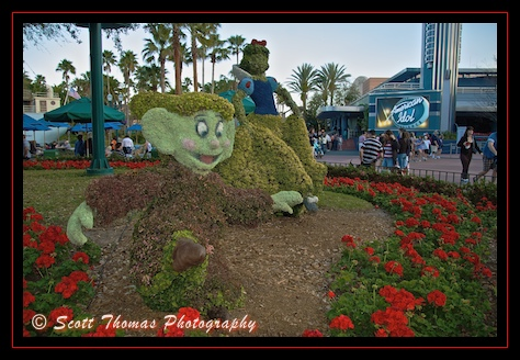 Topiaries of Snow White and Dopey dancing in Disney's Hollywood Studios, Walt Disney World, Orlando, Florida
