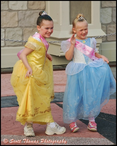 Two young princesses sporting the latest in royal footwear in the Magic Kingdom, Walt Disney World, Orlando, Florida.