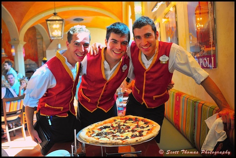 Servers posing with a creation from the Via Napoli chefs in Epcot's Italy pavillion, Walt Disney World, Orlando, Florida.