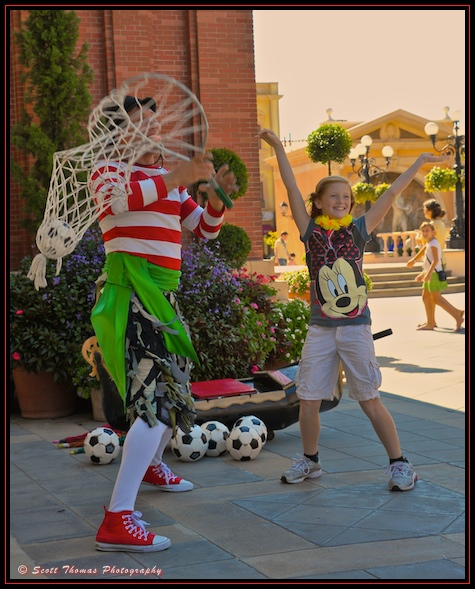 Interactive juggler Sergio entertaining guests at Italy's pavilion in Epcot's World Showcase, Walt Disney World, Orlando, Florida