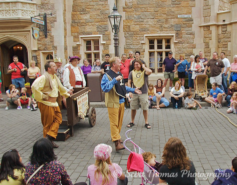 The World Showcase Players entertaining guests in Epcot's United Kingdom pavilion, Walt Disney World, Orlando, Florida