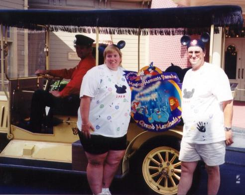 Karen and Paul in Front of Grand Marshall Car
