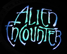 Alien Encounter Sign at Night